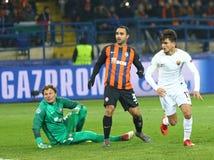 UEFA Champions League: Shakhtar Donetsk v Roma. KHARKIV, UKRAINE - FEBRUARY 21, 2018: Cengiz Under of AS Roma in white scores a goal against Shakhtar Donetsk royalty free stock photography