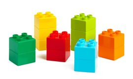 Samples of coloured plastic toy bricks. On white stock photo