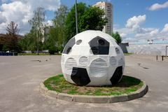 Kharkiv, Ukraine, July, 2019 Football ball installation near sport complex and stadium. City landscape in summer day. Decorated. Ventilating tower of modern stock images