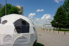 Kharkiv, Ukraine, July, 2019 Football ball installation near sport complex and stadium. City landscape in summer day. Decorated. Ventilating tower of modern royalty free stock image