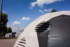 Kharkiv, Ukraine, July, 2019 Football ball installation near sport complex and stadium. City landscape in summer day. Decorated. Ventilating tower of modern royalty free stock photos