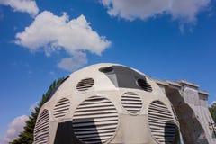 Kharkiv, Ukraine, July, 2019 Football ball installation near sport complex and stadium. City landscape in summer day. Decorated. Ventilating tower of modern stock photo