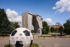 Kharkiv, Ukraine, July, 2019 Football ball installation and outside climbing wall near sport complex and stadium. City landscape. In summer day. Decorated stock photo
