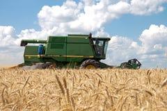 KHARKIV, UKRAINE - JULY 12, 2011: Harvesting wheat field in Kharkiv Oblast in the Ukraine Royalty Free Stock Photography