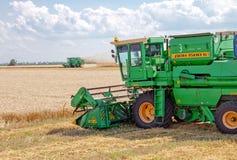 KHARKIV, UKRAINE - JULY 12, 2011: Harvesting wheat field in Kharkiv Oblast in the Ukraine Stock Photography