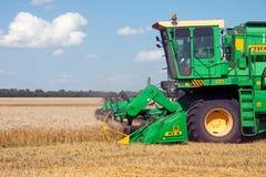 KHARKIV, UKRAINE - JULY 12, 2011: Harvesting wheat field in Kharkiv Oblast in the Ukraine Stock Photo