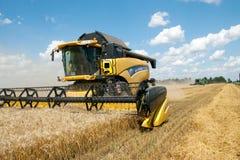 KHARKIV, UKRAINE - JULY 12, 2011: Harvesting wheat field in Kharkiv Oblast in the Ukraine Royalty Free Stock Photo