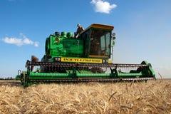 KHARKIV, UKRAINE - JULY 12, 2011: Harvesting wheat field in Kharkiv Oblast in the Ukraine Royalty Free Stock Image