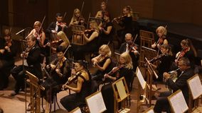 KHARKIV, UKRAINE, 29 JUNE 2017 : Concert of the symphony orchestra. violins stock video footage