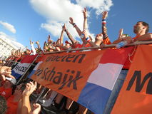 KHARKIV, UKRAINE - JUNE 2012: Dutch football supporers dressed in the national colour Orange. The fans are supporting the national Stock Photography