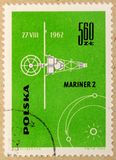 Old post stamp of Poland, dedicated to space exploration and first satellites. KHARKIV, UKRAINE - MARCH 5, 2018: Old post stamp of Poland, dedicated to space royalty free stock images