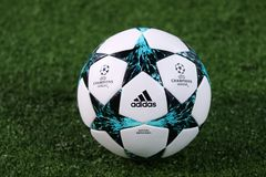 Official UEFA Champions League match ball. KHARKIV, UKRAINE - NOVEMBER 1, 2017: Official UEFA Champions League match ball on the grass during UEFA Champions Stock Photos