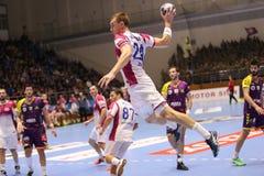 KHARKIV, UKRAINE - SEPTEMBER 22: EHF Men's Champions League match between HC Motor Zaporozhye and HBC Nantes. KHARKIV, UKRAINE - SEPTEMBER 22: Ievgen Zhuk shoots Royalty Free Stock Image
