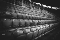 KHARKIV, UKRAINE - SEPTEMBER 19, 2018: A row of seats and a place for fans in the stadium during UEFA Champions League match. Between Shakhtar Donetsk vs TSG royalty free stock images