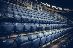 KHARKIV, UKRAINE - SEPTEMBER 19, 2018: A row of seats and a place for fans in the stadium during UEFA Champions League match. Between Shakhtar Donetsk vs TSG royalty free stock image