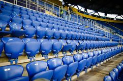 KHARKIV, UKRAINE - SEPTEMBER 19, 2018: A row of seats and a place for fans in the stadium during UEFA Champions League match. Between Shakhtar Donetsk vs TSG royalty free stock photography