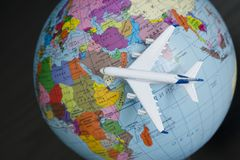 KHARKOV, UKRAINE- 13 APRIL 2018: Airplane on the globe. Travel c. Oncept. Close up stock image