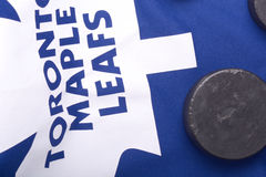 KHARKOV UKRAINE JANUARY 22: Toronto Maple Leafs jersey and old hockey puck Stock Image