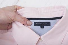 KHARKOV, UKRAINE- NOVEMBER 07 2018: Collar of pink shirt in fem. Ale hand. Fashionable concept royalty free stock image
