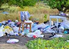 Kharkov, Ukraine - September 7, 2018: Garbage dump in the field, old table and chair royalty free stock images