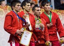Khasanov E , Sukhomlinov E , Ernazov S , Serikov N , en el podio Imágenes de archivo libres de regalías