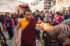 KHATMANDU, NEPAL - Buddhist pilgrims near stupa Boudhanath during festive solemn Puja Royalty Free Stock Photography