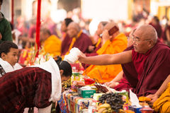KHATMANDU, NEPAL - Unidentified tibetan Buddhist monks near stupa Boudhanath during festive Puja Stock Images