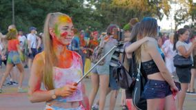 Holi pictures phone of girl on festival of colored paint,. Kherson, Ukraine 30 July 2017: Holi pictures phone of girl on Festival of Colored Paint, Outdoors in stock video footage