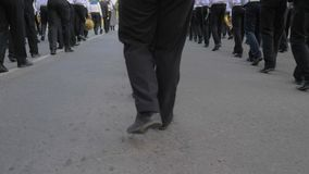 Legs of young sailors marching with musical instruments in hand on parade in the street stock footage