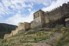 Khertvisi Castle Wall Common View. Khertvisi Huge Fortified Castle Wall Common View with Blue Sky stock photography