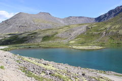 Khibiny Massif. Mountain lake with a beautiful color of water Royalty Free Stock Photo