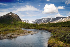 Khibiny mountain. River in mountains in the North of Russia, summer Royalty Free Stock Photo