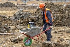 Khimki, Russia - June 13, 2018: Construction worker wheelbarrow stock photo