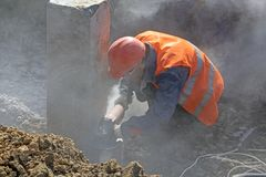 Worker at the construction site royalty free stock photo