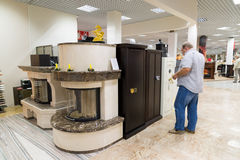 Khimki, Russia - September 03.2016. The buyer chooses metal safes in largest furniture store Grand Royalty Free Stock Photos
