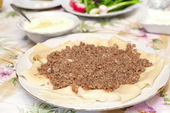 Khinkal. Traditional Azeri meal. Dough topped with choipped meat Stock Photo