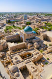 Khiva from air. Scenic aerial view of old town in Khiva, Uzbekistan with large mosque stock photos