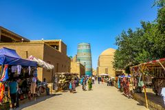 Khiva Old City. Khiva Old Town Souvenir Shops with Walking People Kalta Minor Minaret and West Gate Ota Darvoza stock photos