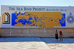 Khiva: tourists at the Silk Road map royalty free stock photography