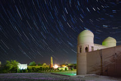 Khiva. Western gate (Ata Darvoza) to ancient town of Itchan Kala at night with star trails. The city of Khiva, Uzbekistan royalty free stock photography