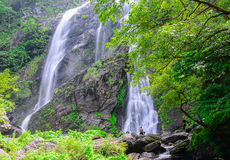 Khlong lan waterfall with people are relaxing, famous natural to Stock Image