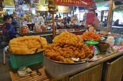 Khlong Lat Mayom floating market in Bangkok. Food stalls at Khlong Lat Mayom floating market in Bangkok, Thailand Stock Photo
