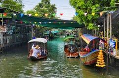 Khlong Lat Mayom floating market in Bangkok. Tour boats on the canal at Khlong Lat Mayom floating market in Bangkok, Thailand royalty free stock photos