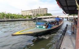 Khlong Saen Saep Express Boat. BANGKOK,THAILAND - APR 3 : The Khlong Saen Saep Express Boat  arrives at a pier on April 3, 2013 in Bangkok, Thailand Stock Photo