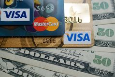VISA and Mastercard credit card with american dollars. Khmelnitskyi, Ukraine - May 5, 2019: VISA and Mastercard credit card with american dollars. Finance stock photo
