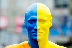 Khmelnytskyi. Ukraine. October 2018. Sculpture by Viktor Sidorenko. The sculpture of a man whose head is painted in the national. Colors of Ukraine - yellow and stock image