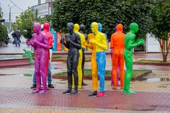 Khmelnytskyi.Ukraine. October 2018. Sculptures by V. Sidorenko. Multicolored sculptures of people. The dialogue of representatives of different races stock image