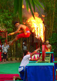 Khmer actors during the theatrical performance. China villiage. Fly thru the fire circle Stock Photos