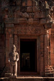 Khmer Ancient Sculptures. Ancient Porter Sculptures in front of the door of main temple in Phanom Rung Historical Park, Buriram, Thailand. It's Carved from pink Royalty Free Stock Photo