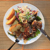 Khmer barracuda steak with vegetable salad Stock Photography